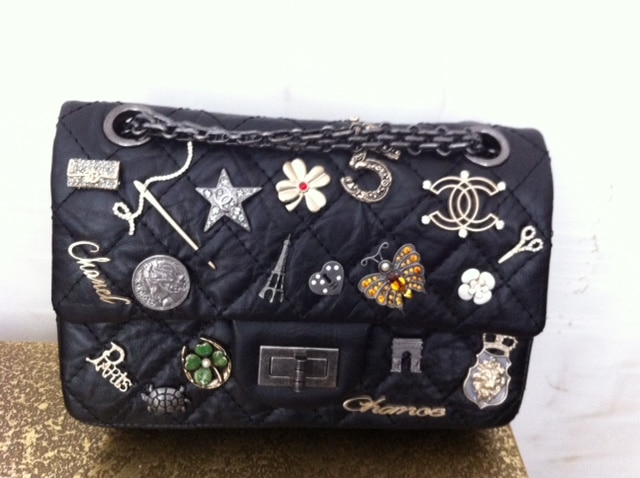 3efd0979e402 Chanel Lucky Charms Flap Bag Reference Guide   Spotted Fashion