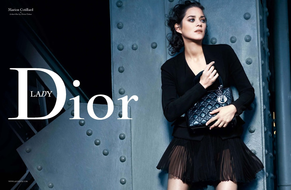 cb69f92f430d Marion Cotillard carrying Miss Dior Python Bag