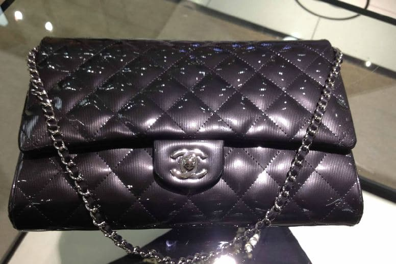 a215435b947ea8 Chanel Clutch with Chain Bag Reference Guide | Spotted Fashion