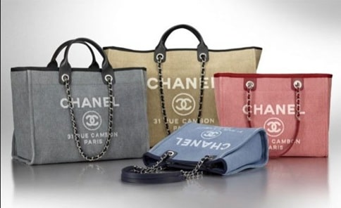 f936666f34ee52 Chanel Deauville Canvas Tote Bag Reference Guide – Spotted Fashion