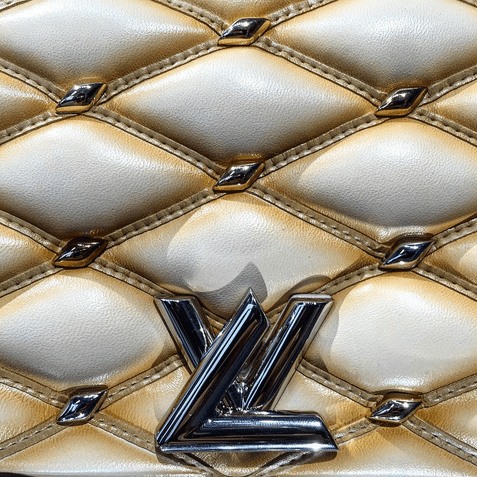 Louis Vuitton Studs with Malletage