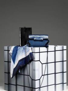 Delvaux Noir and Bleu de Prusse Tempete Clutch Bags