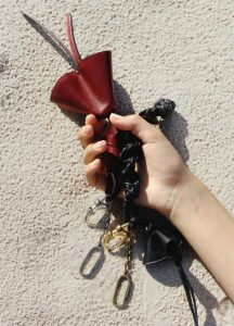 Celine Burgundy Grigri Doll Keyring and Black Grigri Braided Keyring