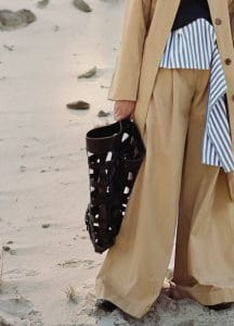 Celine Trench Coat / Sleeveless Top / T-Shaped Top / Wide Leg Trousers / Black Holdall Medium Bag : Rodeo V Neck Pump