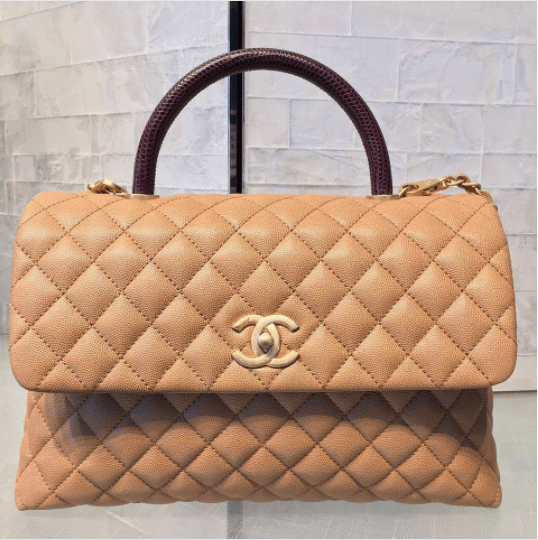 5c7325f20906 Chanel Beige Calfskin Lizard Medium Coco Handle Bag. IG  kensluxury