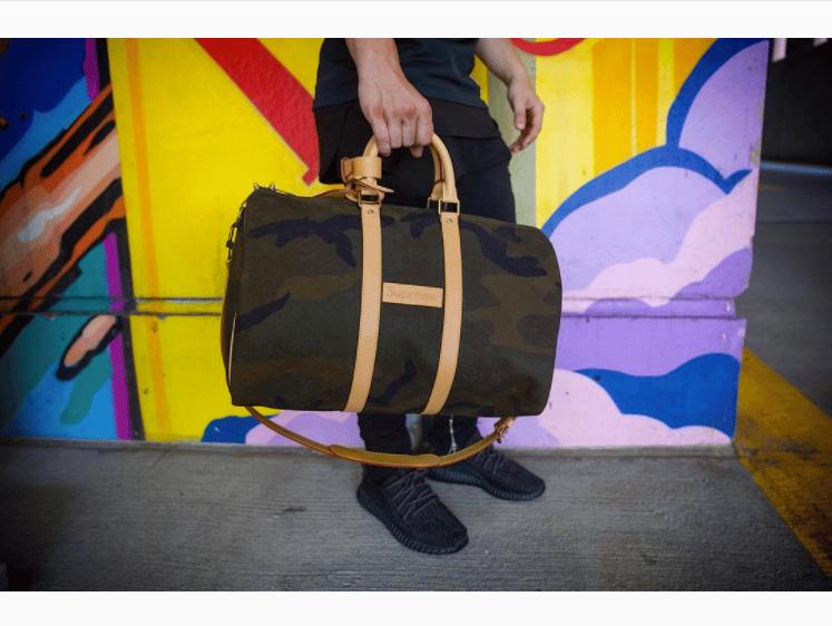 5adf8da0ea91 Louis Vuitton x Supreme Monogram Camo Keepall 45 Bandouliere Bag 2. IG   stockx