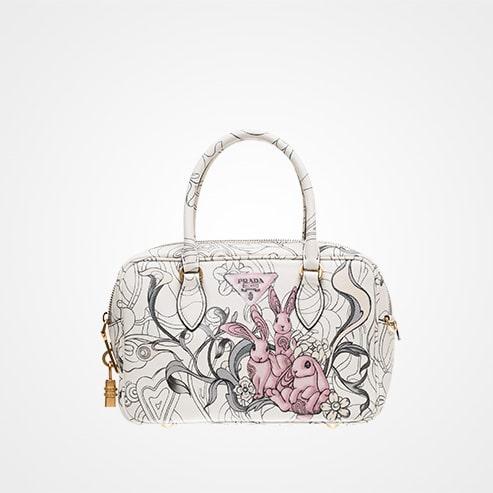 bb13d27d7cd2 Prada Opaline Bunny Embossed Top Handle Bag · Prada White Bunny Printed ...