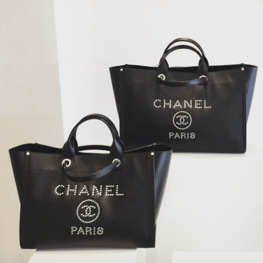 abd4508a7c99 IG  tiffanyboutiquecy. Chanel Black Studded Calfskin Deauville Medium  Shopping Bag 2. IG  laulayluxury