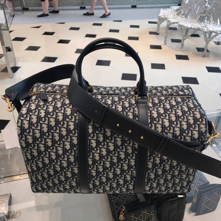 a59ebb910987 Dior Oblique Signature Canvas Bag Reference Guide
